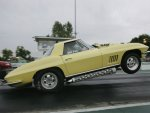 1967ChevroletCorvette-yellow-hardtop-wheelstand.jpg